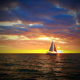 Just another Florida Sunset by Lorna Littrell - Landscapes Sunsets & Sunrises ( sunset, florida, travel, boat )