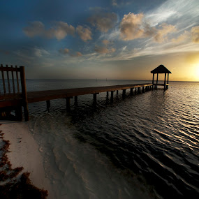 Dock at sunrise by Cristobal Garciaferro Rubio - Landscapes Waterscapes ( clouds, water, cancun, sky, sunrise, dock, sun )