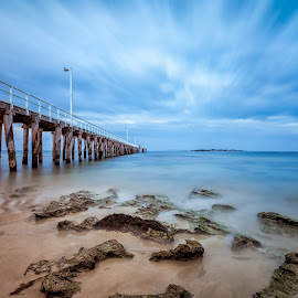 Pier Into The Distance by Chen Hopwood - Landscapes Waterscapes ( water, clouds, geelong, poitlonsdale, australianphotography, ocean, seascape, landscape, lucroit, headland, hitechfilters, landscapephotography, victoria, rocks, longexposure, relax, tranquil, relaxing, tranquility,  )