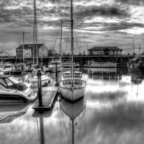 A boat in Ramsgate Harbour by Mick Heywood - Transportation Boats ( b&w, harbour, cloudy, sea, ramsgate, boat )
