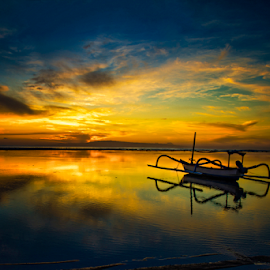 Golden Light by JJ Haruki - Landscapes Sunsets & Sunrises ( reflection, bright, silhouette, tropical, beauty, beach, yellow, travel, panorama, sun, sky, nature, sunny, indonesia, light, evening, climate, water, orange, beautiful, twilight, journey, sea, horizon, boat, paradise, sunlight, morning, dusk, amazing, dawn, red, blue, color, sunset, background, outdoor, wave, cloud, summer, sunrise, scenery, natural, golden, panoramic,  )