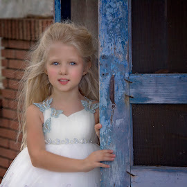 blue eyes by Carole Brown - Babies & Children Child Portraits ( old blue door, white gown, gorgeous, blonde hair, blue eyes )