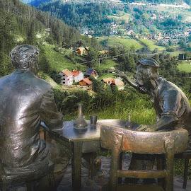 Hunting stories by Mirko Ilić - Digital Art People ( hunter, mountains, statue, village, green, landscape,  )