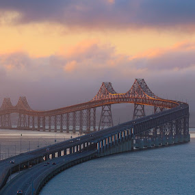 Bridge over the San Francisco bay by Robin Rawlings Wechsler - Buildings & Architecture Bridges & Suspended Structures ( clouds, water, nature, fog, bay, san francisco bay, seascape, architecture, sunrise, bridge, landscape )