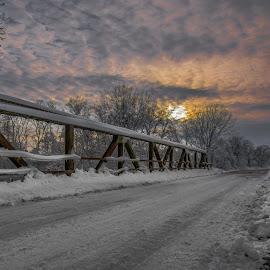 Cold Iron  by Bob White - Buildings & Architecture Bridges & Suspended Structures ( bridge snow sunset clouds love sun )