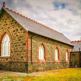 NO NAME CHURCH by Jennifer  Loper  - Buildings & Architecture Places of Worship ( arched windows, rock exterior, grass, church, clouds, water )