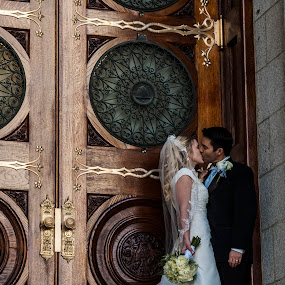 Wedding kiss at doors by Kyley Hansen - Wedding Bride & Groom ( kiss, wedding, couple, bride, groom )