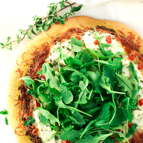 Walnut Pesto Pizza with Herbed Ricotta, Tomato, and Arugula