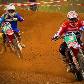 Crazy Pursuit! by Marco Bertamé - Sports & Fitness Motorsports ( follower, chasing, speed, pursuit, race, bike, inclined, red, motocross, blue, dust, leader, clumps, motorcycle, accelerating, competition )