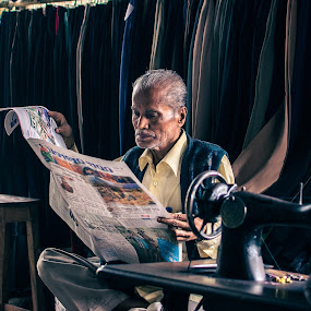 Keeping updates by Rahat Amin - People Portraits of Men ( lifestyle, timepass, old man, leisure, nikon, people, dd5100, newspaper )