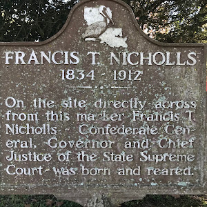 On the site directly across from this marker Francis T. Nicholls — Confederate General, Governor and Chief Justice of the State Supreme Court — was born and reared.