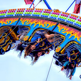 Upside Down and Tingling all Over by Garry Dosa - City,  Street & Park  Amusement Parks ( ride, exhileraing, amusement, action, hair, people, spring, fair, colours )