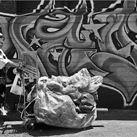 pushing trolly by Leon Pelser - City,  Street & Park  Street Scenes ( iso 640, no flash, 1/500, f 4.5, auto wb,  )