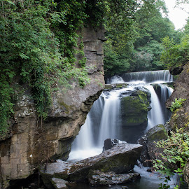Aberdulais Waterfall. by Paul Coomber - Landscapes Waterscapes ( wales, waterfall, long exposure, travel, landscape )