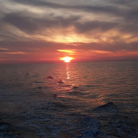 Sunset on the Ocean by Chris Gray - Landscapes Sunsets & Sunrises ( water, clouds, waves, sunset, ocean,  )