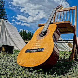 Waiting To Play by Barbara Brock - Artistic Objects Musical Instruments ( old tents, guitar outside, cloudy skies, guitar )