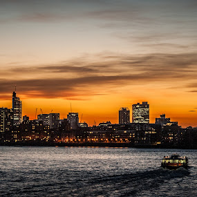 London from Canary Wharf by Matt Cooper - City,  Street & Park  Skylines ( lights, building, red, ferry, bright, horizon, boat )