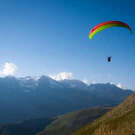 parasailing in French Alps by Lisa Klein - Sports & Fitness Other Sports ( skyline, person, stone, rock, yellow, beach, travel, recreation, people, tandem, height, sky, woman, action, wind, parasail, leisure, tourism, fun, holiday, tourist, vacation, fly, horizontal, floating, active, air, french alps, colorful, xtreme, caribbean, parasailing, resort, couple, france, activity, parachute, man, water, extreme, sport, adult, boat, dangerous, up, red, color, blue, outdoor, summer, high )