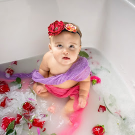 Bathing Beauty by Jeannie Meyer - Babies & Children Child Portraits ( baby portrait, water, purple, pinks and purples, roses, pink, baby, flowers, one year old, milk bath )