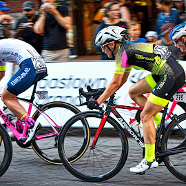 Racing By by Garry Dosa - Sports & Fitness Cycling ( cyclists, outdoors, race, road race, action, cycling, people, speed, women )