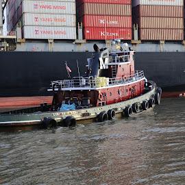 Tug boat guiding barge. by Larry Shehane - Transportation Boats