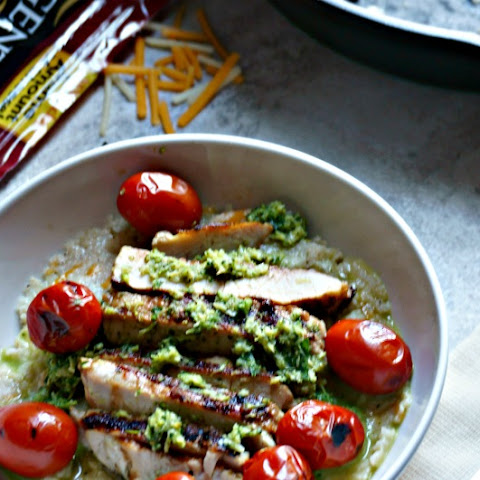 Grilled Pork Tenderloin with Cheesy Grits, Charred Tomatoes, and Broccoli Pesto
