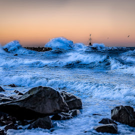The Lighthouse by Patric Rosberg - Digital Art Places ( harbor, silhouette, stone, ocean, storm, sky, nature, halland, weather, wet, light, rocks, golden hour, water, wild, element, sweden, urd, beautiful, sea, seascape, powerful, landmark, dawn, pattern, blue, color, outdoors, background, scenery, sunrise, energy )