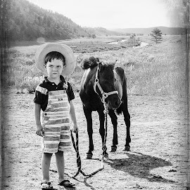 Bond by Evan Jones - Babies & Children Children Candids ( home, cowboy, effect, horses, vintage, black and white, family, horse, kids, country )