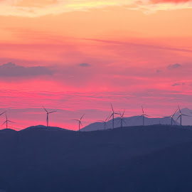 Windmills in sunset by Miho Kulušić - Landscapes Mountains & Hills ( clouds, mountains, red sky, windy, sunset, ecology, windmills, eco, energy )