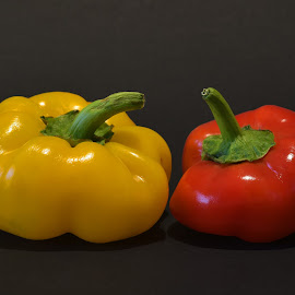 Red & Yellow by Marco Bertamé - Food & Drink Fruits & Vegetables ( red pepper, red, green, pepper, yellow, curved, yellow pepper, vegetable, black )