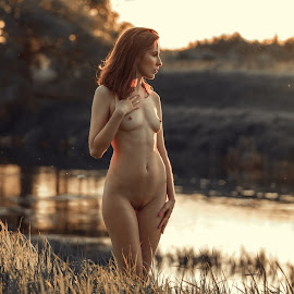 charm of the sunset by Dmitry Laudin - Nudes & Boudoir Artistic Nude ( nude, girl, sunset, yellow, light, summer heat, sun, river )