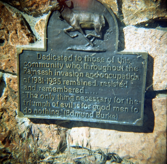 At the base of a flagpole in front of the tiny Post Office in Antelope, Oregon, 97001. This small, nearly non-existent town has apparently had some interesting recent history. The plaque reads as ...