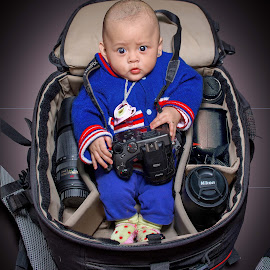 Baby in Camera Bag by Kriswanto Ginting's - Babies & Children Babies ( baby portrait, nikonshooter, nikond7100, bag, nikonindonesia, camera, baby girl, baby face, baby, baby photography, toddler, nikon, black,  )