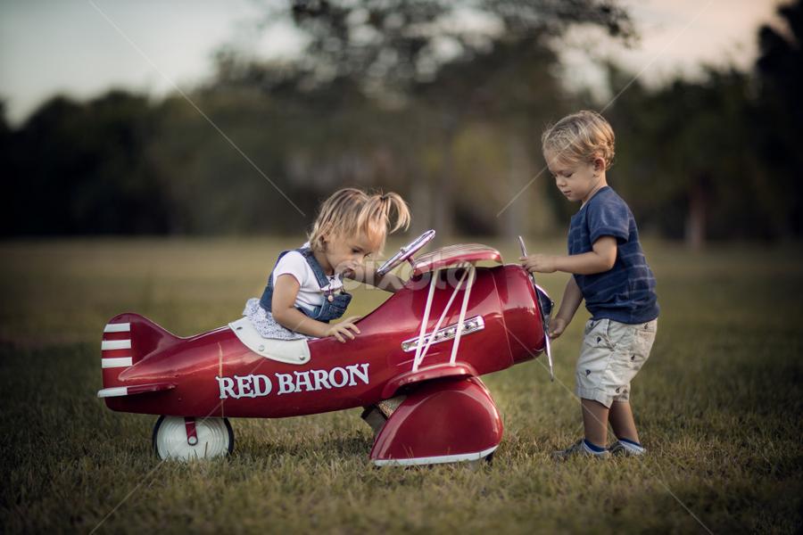 Red Baron by Nemanja Stanisic - Babies & Children Children Candids ( field, playing, girl, red, plane, red baron, children, boy, twins, kid )