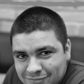 Flirty look by Daniel Sabau - People Portraits of Men ( black and white, romania, smile, man )