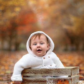Autumn by Emma Thompson - Typography Captioned Photos ( baby portrait, fall leaves, fall colors, autumn leaves, autumn, fall, baby girl, autumn colors, baby, leaves )