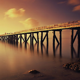 Morning Burn by Jomy Jose - Digital Art Places ( man in boat, auckland, cornwallis, sea, fishing, wharf, new zealand )
