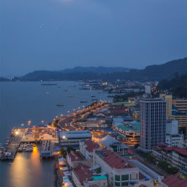 Calmness in the morning at Sandakan, Sabah by Ithni Shaari - Landscapes Travel ( lights, moon, mountains, waterscape, calmness, moonlighting, lights trail, buildings, reflections, seascape, travel, landscape, morning )
