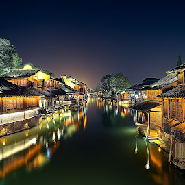 water village at night by Crispin Lee - Buildings & Architecture Homes ( lights, village, night, landscape, travel photography, china )