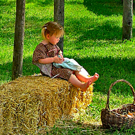 Discovering a Big Toe in the Sunlight by Julie Dant - Babies & Children Children Candids ( girls, little girls, summer scene, picnics, hay bale, pioneer children, calico dress, toddlers, KidsOfSummer )