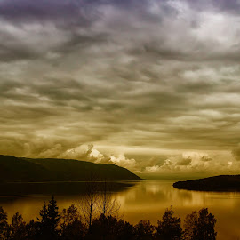 Clouds are reflected in the water. by Øyvind H Edvardsen - Landscapes Cloud Formations ( #espaboller #norway # )