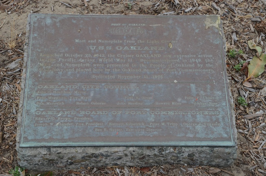One of two plaques near the mast of the USS Oakland.