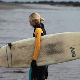 Surfer taking a moment. by Nick Stewart - People Street & Candids ( surfer chick, winter, surfer, woman, sea, beach, coastline )