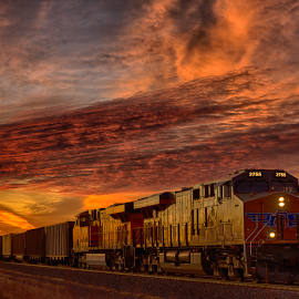 Twilight Train by Ryan Trullinger - Transportation Railway Tracks ( clouds, railroad tracks, dawn, twilight, train )