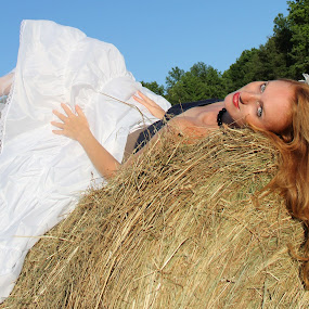 Hay by Freda Nichols - People Portraits of Women ( woman, hay, bales,  )