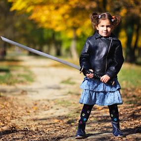 Guardian by Nicu Buculei - Babies & Children Child Portraits ( girl, autumn, children, kids, portrait, sword )