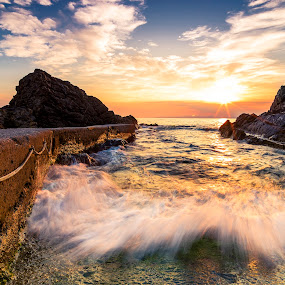 Wave through the rocks by Luca Rosacuta - Landscapes Waterscapes ( sunset, wave, sea, pier, seascape, landscape, rocks )