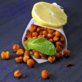 Roasted Chickpea on a paper. by Dipali S - Food & Drink Eating ( salty, nobody, peppers, spicy, indian, yellow, delicious, appetizer, baked, snack, hungarian, curry, crispy, bakery, color, food, background, crunchy, vegetarian, chickpea, chilli, roasted, savory, chickpeas, meal )