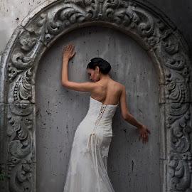 Framed Bride by Xavier Wiechers - Wedding Bride ( sexy, fashion, model, frame, dress, wedding, beautiful, high heels, brunette, bride, rocks, concrete )