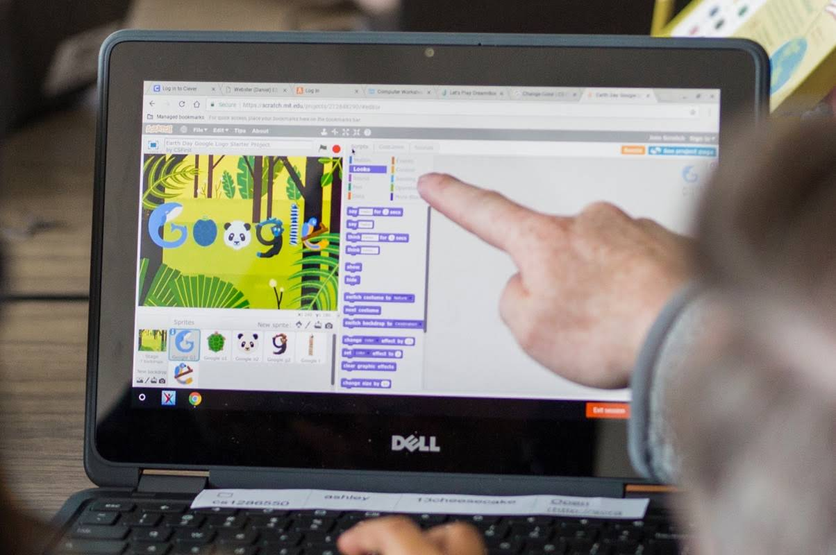 Finger Pointing to a laptop screen
